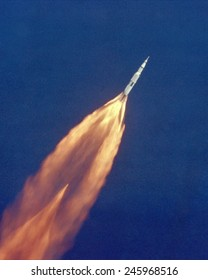 Moon launch. The Apollo 11 Saturn V space vehicle climbs toward orbit after liftoff. In two and a half minutes it was 39 miles above Earth and 55 miles from its launch site. July 16, 1969.