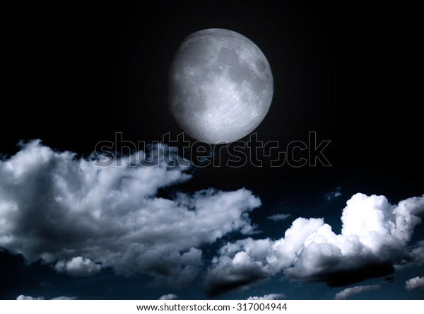 """The moon in the night sky in clouds """"Elements of this image furnished by NASA"""""""