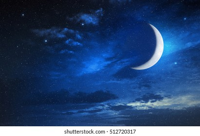 moon in a starry and cloudy sky