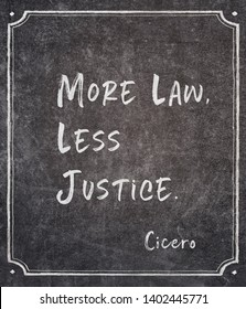 More law, less justice - ancient Roman philosopher Cicero quote written on framed chalkboard