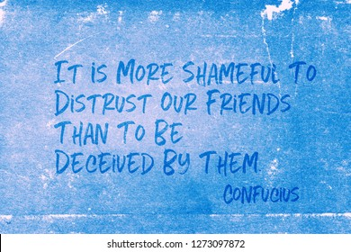 It is more shameful to distrust our friends than to be deceived by them - ancient Chinese philosopher Confucius quote printed on grunge blue paper