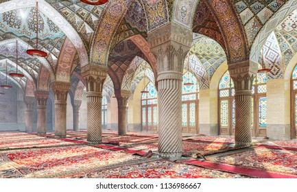 Moroccan columns with arches. Moroccan patterns on arches in the interior. The Nasir ol Molk Mosque. Great hall in Moroccan style. 3D Illustration.