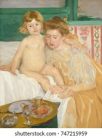 Mother and Child , by Mary Cassatt, 1899, French impressionist oil painting. A well-dressed mother attends her awakening child, with her breakfast tray nearby