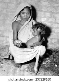 Mother of a starving child begs for help in Calcutta in October 1943.