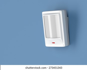 Motion detector attached on blue wall