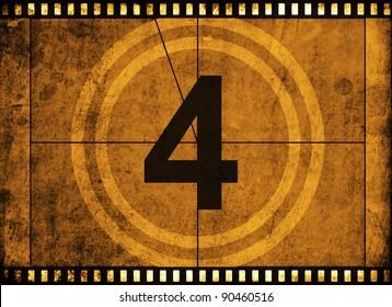 movie film strip with countdown number on grunge background
