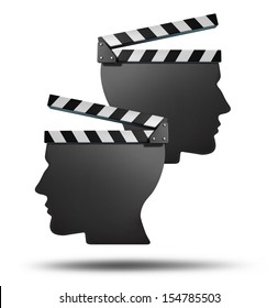 Movie partnership and film group concept with two open cinema clapboards in the shape of a human head as an entertainment business team icon of cinema production or contrasting creative direction.