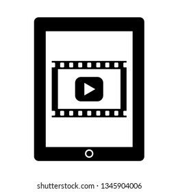 A movie playback mark is displayed on the screen of the tablet.