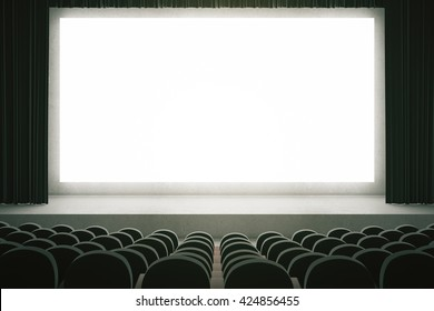 Movie theater with rows of black seats and large blank screen with curtains. Mock up, 3D Rendering