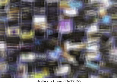Multicolored abstract of many business cards on a bulletin board, with considerable shape blur, for implied themes of information overload and confusion (one of a series)