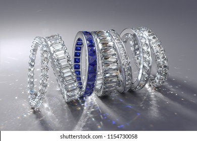 Multiple diamond eternity wedding bands of various styles, caustics rays on white background. 3D rendering