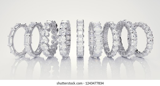 Multiple various diamond eternity wedding rings in line on white glossy background. 3D illustration