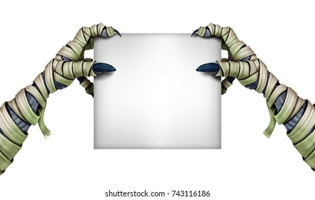 Mummy monster holding blank sign as a halloween zombie hands grabbing a white card as a creepy fall scary symbol fingers isolated.