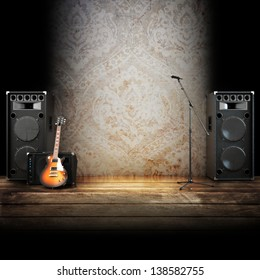 Music stage or singing background, microphone, guitar and speakers with wood flooring. Advertising concept with room for text or copy space