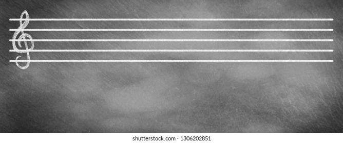 Musical staves with clef on school blackboard