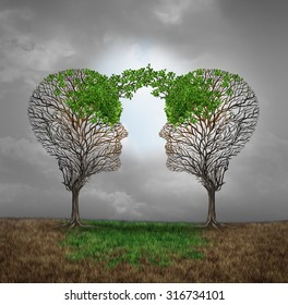 Mutual support and saving one another as a benefit to each other business concept as two sick trees with new leaves growth emerging shaped as a human head providing a revival for success.