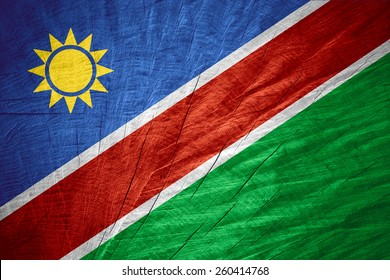 Namibia flag or Namibian banner on wooden texture