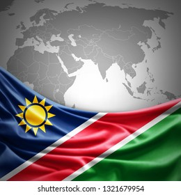 Namibia flag of silk with copyspace for your text or images and world map background -3D illustration