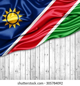 Namibia   flag of silk with copyspace for your text or images and wood background
