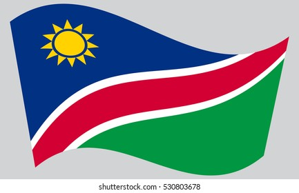 Namibian national official flag. African patriotic symbol, banner, element, background. Correct colors. Flag of Namibia waving on gray background