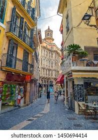 narrow medieval street in the historic centre of Palma de Mallorca, computer graphics - watercolor style