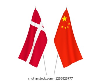 National fabric flags of China and Denmark isolated on white background. 3d rendering illustration.