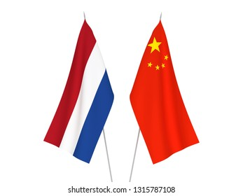 National fabric flags of China and Netherlands isolated on white background. 3d rendering illustration.