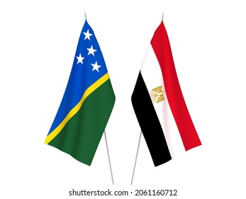 National fabric flags of Egypt and Solomon Islands isolated on white background. 3d rendering illustration.