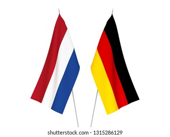 National fabric flags of Germany and Netherlands isolated on white background. 3d rendering illustration.