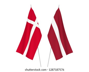 National fabric flags of Latvia and Denmark isolated on white background. 3d rendering illustration.