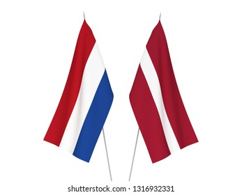 National fabric flags of Latvia and Netherlands isolated on white background. 3d rendering illustration.