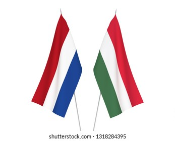 National fabric flags of Netherlands and Hungary isolated on white background. 3d rendering illustration.