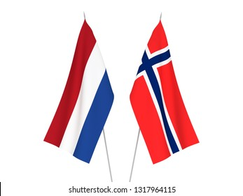 National fabric flags of Norway and Netherlands isolated on white background. 3d rendering illustration.