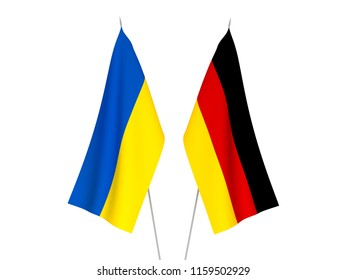 National fabric flags of Ukraine and Germany isolated on white background. 3d rendering illustration.
