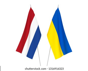 National fabric flags of Ukraine and Netherlands isolated on white background. 3d rendering illustration.