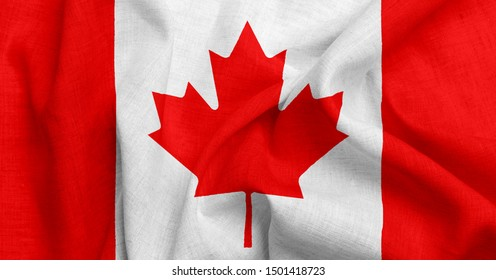 National flag of Canadaon a waving cotton texture background