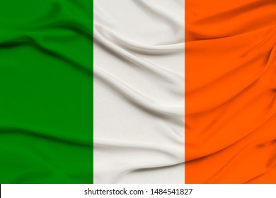 national flag of the country ireland on delicate silk with wind folds, travel concept, immigration, politics, copy space, close-up