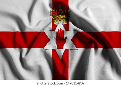 National flag of Northern Ireland on a waving cotton texture background