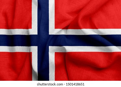 National flag of Norway on a waving cotton texture background