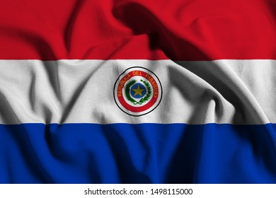 National flag of Paraguay on a waving cotton texture background
