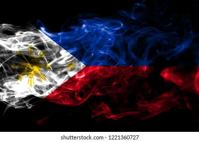 National flag of Philipines made from colored smoke isolated on black background. Abstract silky wave background