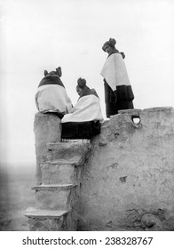 Native Americans, three Hopi women at the top of adobe steps, photograph by Edward S. Curtis, ca 1906.