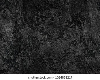 Natural black volcanic seamless stone texture venetian plaster background. Dark volcanic rock venetian plaster stone texture grain pattern. Black seamless grunge charcoal background texture rock coal