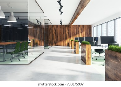 Natural style open space office interior with loft windows, a wooden floor, an aquarium like conference room area and rows of computer desks. 3d rendering
