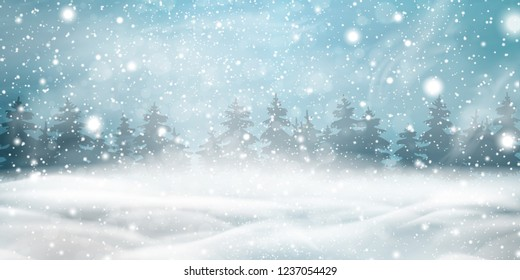 Natural Winter Christmas background with blue sky, heavy snowfall, snowflakes, snowy coniferous forest, snowdrifts. Winter landscape with falling christmas shining beautiful snow