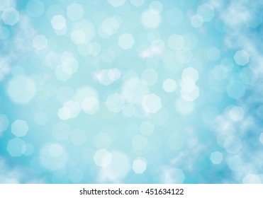 Nature bokeh background with beaches, turquoise waters and white clouds, and a bright sun light. Summer holiday concept.