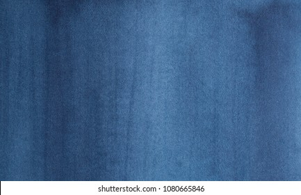Navy blue abstract watercolor background. Empty and clean surface with one main tone for graphic design, backdrops, prints, wallpaper. Handdrawn watercolour gradient painting on textured paper.
