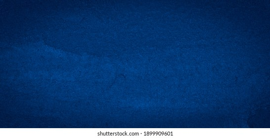 Navy blue watercolor background with drips and spots. Frame with copy space.