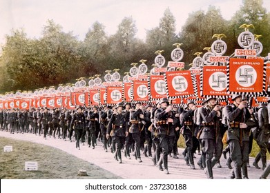 Nazi Germany, Nazi SS troops marching with victory standards at the Party Day rally in Nuremberg, 1933.