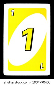 Negotin, Serbia, March 12, 2021, Uno playing card. One in yellow color playing card isolated on black.